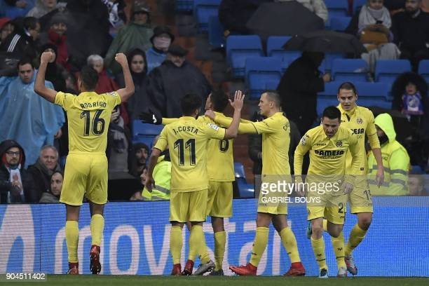 Villarreal's players celebrate after scoring a goal during the Spanish league football match between Real Madrid and Villarreal at the Santiago...