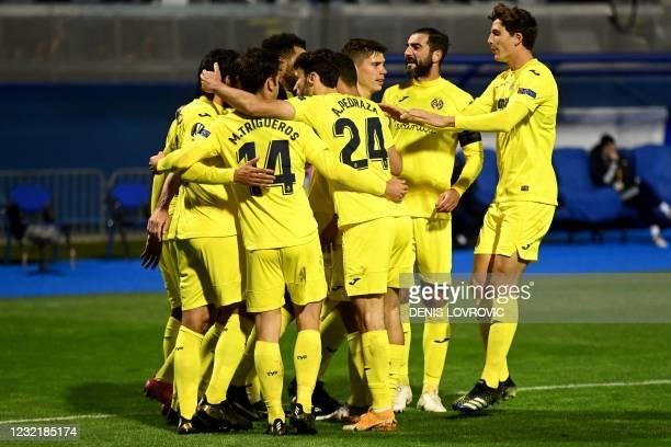 Villarreal's players celebrate after scoring during the UEFA Europa League quarter-final football match between Dinamo Zagreb and Villarreal CF at...