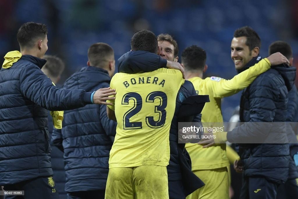 Villarreal's players celebrate at the end of the Spanish league football match between Real Madrid and Villarreal at the Santiago Bernabeu Stadium in Madrid on January 13, 2018. /