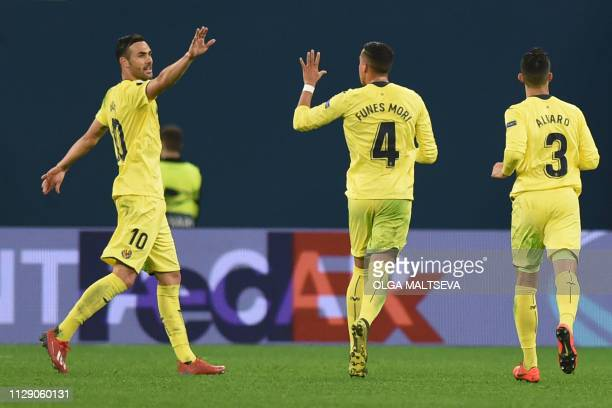 Villarreal's players celebrate the team's third goal during the Europa League round of 16 first leg football match between FC Zenit and Villarreal CF...