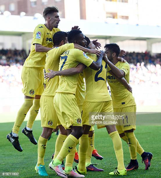 Villarreal's players celebrate their first goal during the Spanish league football match between SD Eibar and Villarreal CF at the Ipurua stadium in...