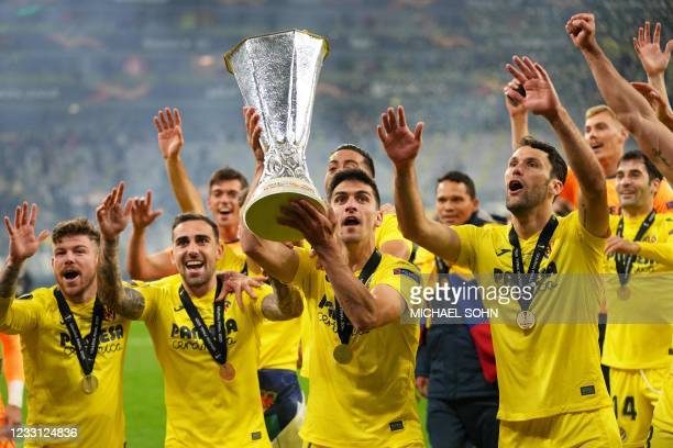 Villarreal's players celebrate with the trophy after winning the UEFA Europa League final football match between Villarreal CF and Manchester United...