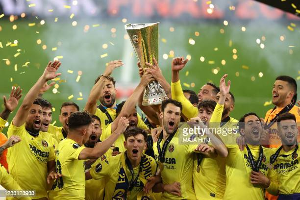 Villarreal's players lift the trophy after winning the UEFA Europa League final football match between Villarreal CF and Manchester United at the...