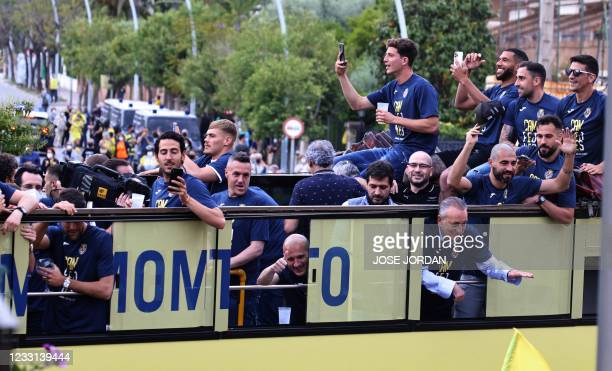 Villarreal's players parade aboard an open-top bus to celebrate their Europa League victory in Vila-real on May 27, 2021.
