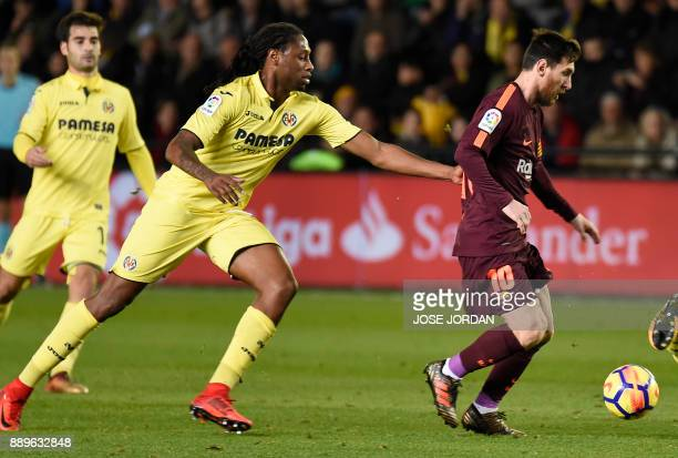 Villarreal's Portuguese defender Ruben Semedo vies with Barcelona's Argentinian forward Lionel Messi during the Spanish league football match between...