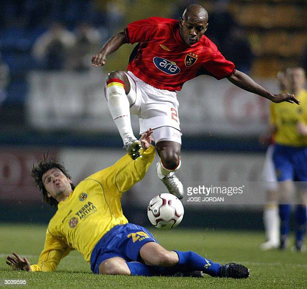 Villarreal's Roger Garcia tackles Galatasaray's Brazilian Cesar Prates during their UEFA cup third round football match at the Madrigal Stadium in...
