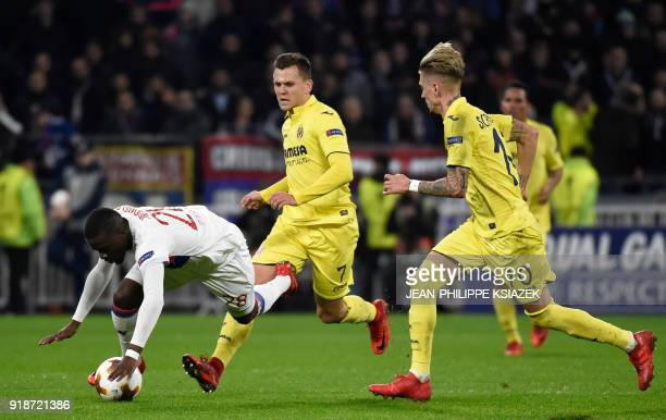 Villarreal's Russian midfielder Denis Cheryshev and Villarreal's Spanish midfielder Samuel Castillejo fight for the ball with Lyon's French defender...