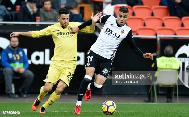 Villarreal's Serbian defender Antonio Rukavina vies with Valencia's Belgian midfielder Andreas Pereira during the Spanish league football match...