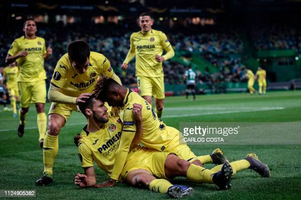 TOPSHOT Villarreal's Spanish defender Alfonso Pedraza celebrates with Villarreal's Nigerian midfielder Samuel Chimerenka Chukwueze and Villarreal's...