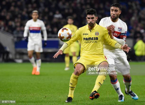 Villarreal's Spanish defender Alvaro fights for the ball with Lyon's French midfielder Nabil Fekir during the Europa League football match Olympique...