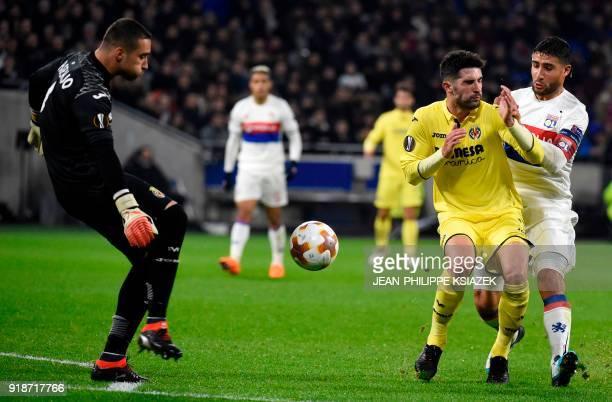 Villarreal's Spanish defender Alvaro fights for the ball with Lyon's French midfielder Nabil Fekir as Villarreal's goalkeeper Asenjo looks on during...