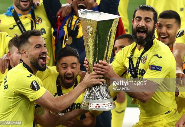 Villarreal's Spanish defender Mario Gaspar and Villarreal's Spanish defender Raul Albiol celebrate with the trophy after winning the UEFA Europa...