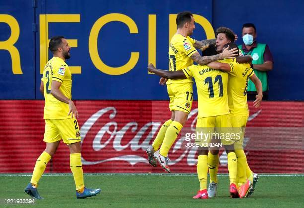 Villarreal's Spanish defender Pau Torres celebrates with teammates after scoring during the Spanish league football match Villarreal CF against...
