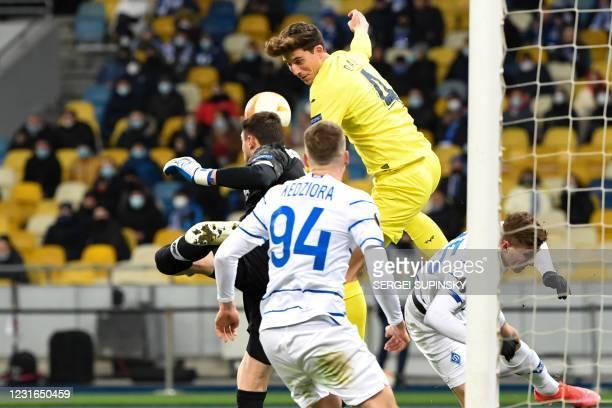 Villarreal's Spanish defender Pau Torres in action against Dynamo Kiev's Ukrainian goalkeeper Heorhiy Bushchan during the UEFA Europa League round of...