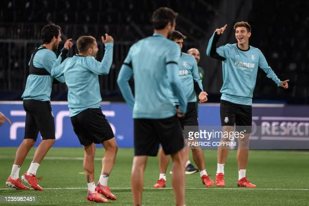 Villarreal's Spanish defender Pau Torres reacts with teammates during a training session on the eve of the UEFA Champions League group F football...