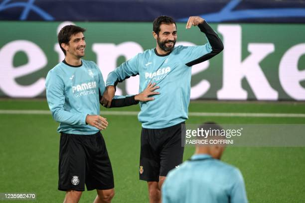 Villarreal's Spanish forward Gerard Moreno and Spanish defender Raul Albiol react during a training session on the eve of the UEFA Champions League...