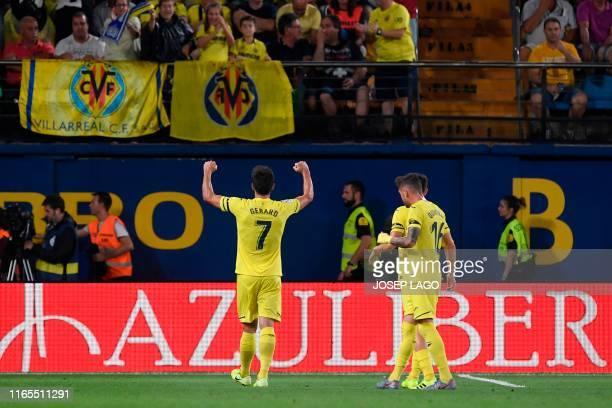 Villarreal's Spanish forward Gerard Moreno celebrates after scoring during the Spanish league football match Villarreal CF against Real Madrid CF at...
