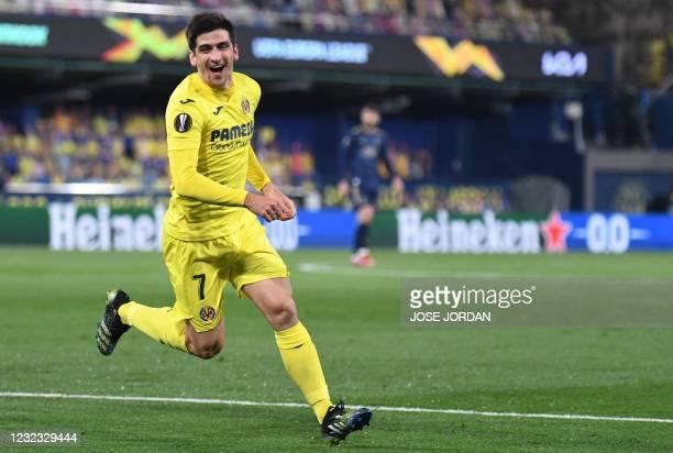 Villarreal's Spanish forward Gerard Moreno celebrates after scoring during the UEFA Europa League quarter final second leg football match between...