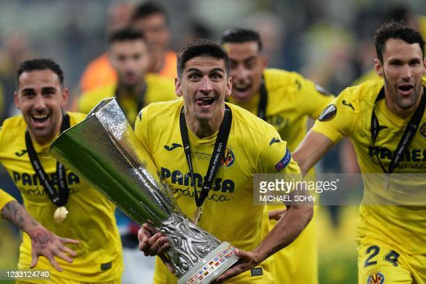 Villarreal's Spanish forward Gerard Moreno poses for pictures with the trophy after winning the UEFA Europa League final football match between...