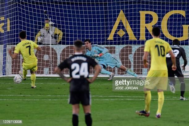 Villarreal's Spanish forward Gerard Moreno scores a penalty during the Spanish League football match between Villarreal and Real Madrid at La...