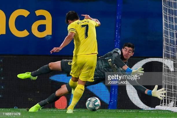 Villarreal's Spanish forward Gerard Moreno scores against Real Madrid's Belgian goalkeeper Thibaut Courtois during the Spanish league football match...