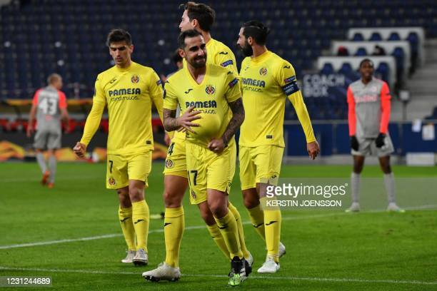 Villarreal's Spanish forward Paco Alcacer celebrates scoring the opening goal with his teammates during the UEFA Europa League last-32, first Leg...