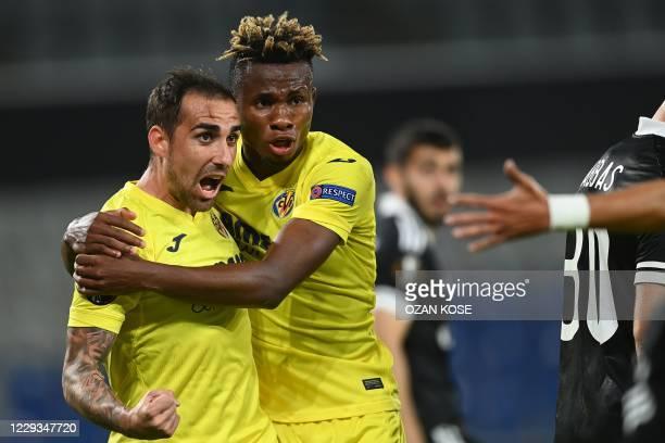Villarreal's Spanish forward Paco Alcacer celebrates with Villarreal's Nigerian midfielder Samuel Chukwueze after scoring during the UEFA Europa...