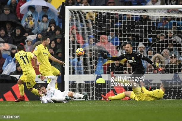 Villarreal's Spanish goalkeeper Sergio prepares to block a shot on goal by Real Madrid's Portuguese forward Cristiano Ronaldo during the Spanish...