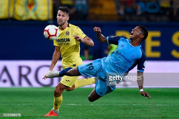 Villarreal's Spanish midfielder Alfonso Pedraza challenges Girona's Honduran midfielder Anthony Lozano during the Spanish league football match...