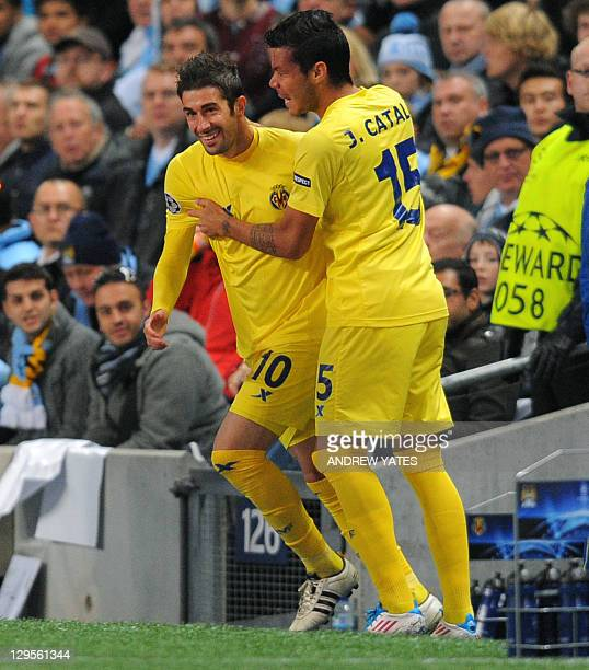 Villarreal's Spanish midfielder Cani celebrates with Villarreal's Spanish defender José Catalá after scoring the opening goal during their UEFA...