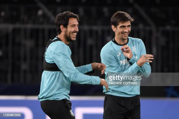 Villarreal's Spanish midfielder Daniel Parejo and Spanish forward Gerard Moreno react during a training session on the eve of the UEFA Champions...