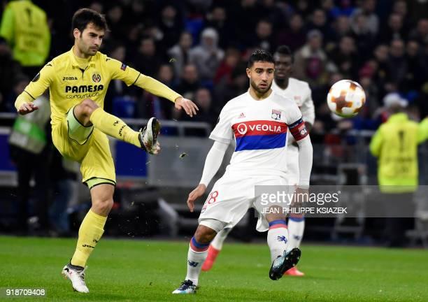 Villarreal's Spanish midfielder Manu Trigueros vies with Lyon's French midfielder Nabil Fekir during the UEFA Europa League football match between...