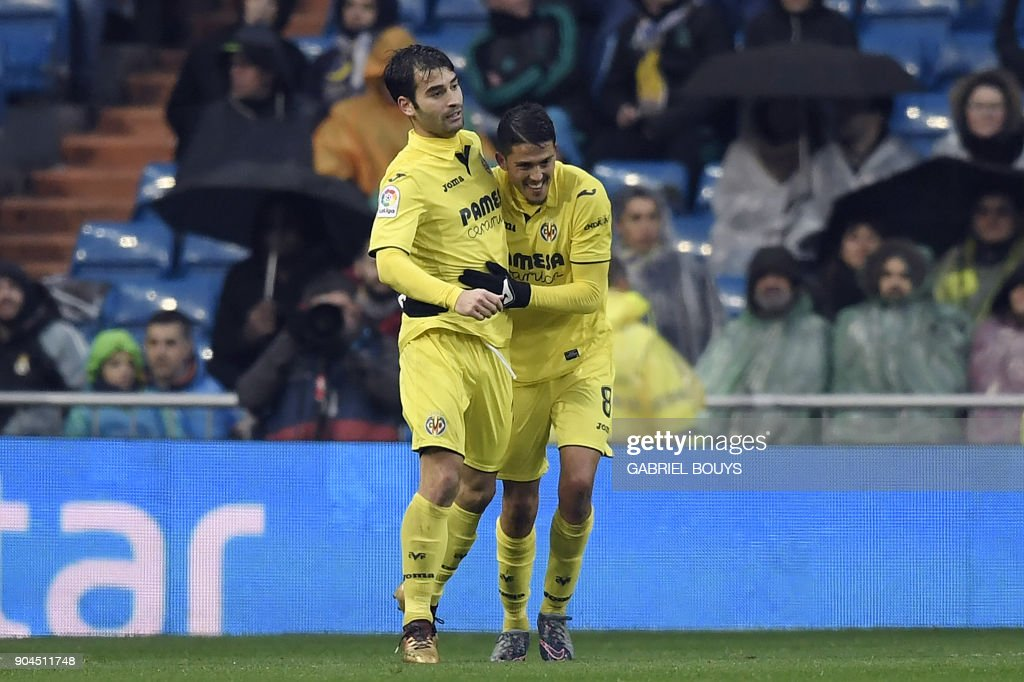 Villarreal's Spanish midfielder Pablo Fornals (R) celebrates with Villarreal's Spanish midfielder Manuel Trigueros Munoz after scoring a goal during the Spanish league football match between Real Madrid and Villarreal at the Santiago Bernabeu Stadium in Madrid on January 13, 2018. /