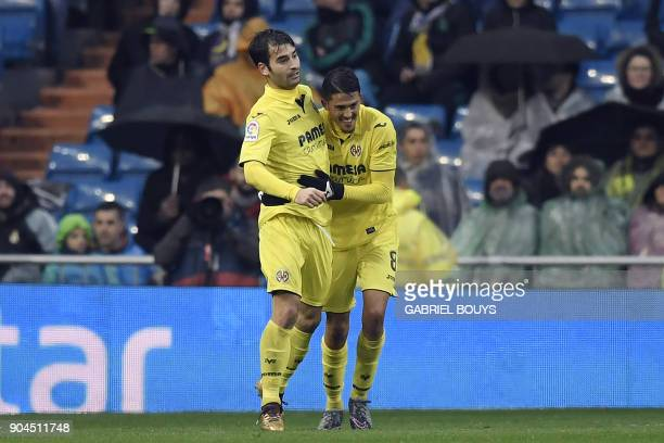 Villarreal's Spanish midfielder Pablo Fornals celebrates with Villarreal's Spanish midfielder Manuel Trigueros Munoz after scoring a goal during the...