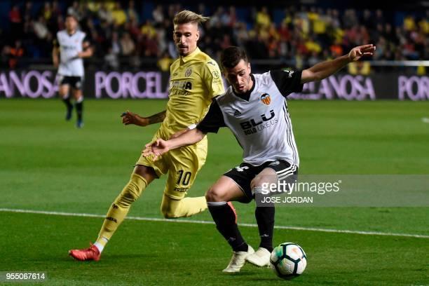 Villarreal's Spanish midfielder Samuel Castillejo challenges Valencia's Spanish defender Jose Gaya during the Spanish league football match between...