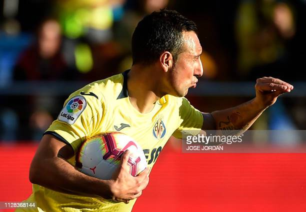Villarreal's Spanish midfielder Santi Cazorla celebrates a goal during the Spanish league football match between Villarreal CF and Deportivo Alaves...