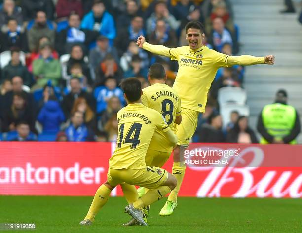 Villarreal's Spanish midfielder Santiago Cazorla celebrates his goal with teammates during the Spanish league football match between Real Sociedad...