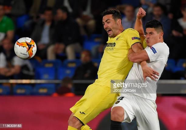 Villarreal's Spanish midfielder Vicente Iborra vies with Valencia's Argentinian defender Facundo Roncaglia during the UEFA Europa league quarter...