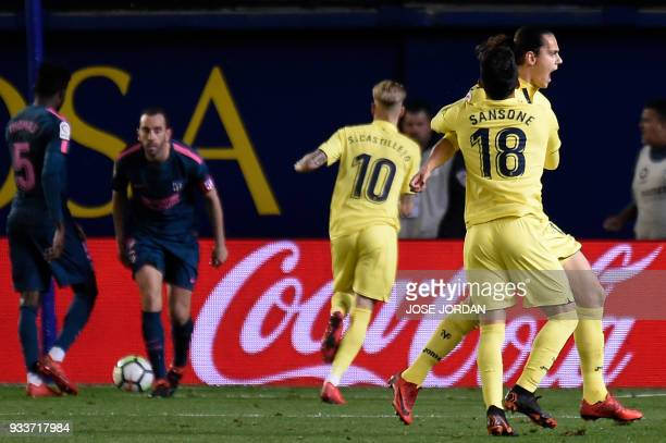 Villarreal's Turkish forward Enes Unal celebrates a goal with Villarreal's Italian forward Nicola Sansone during the Spanish League football match...