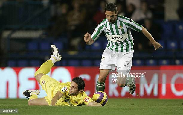 Villarreal's Turkish Kahveci Nihat falls by Betis's Cesar Arzu during their Spanish league football match at the Madrigal Stadium in Valencia 09...