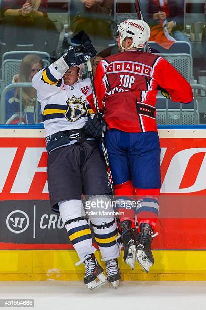 Ville Korhonen of Espoo Blues in action with Brent Raedeke of Adler Mannheim during the Champions Hockey League round of thirty-two game between...