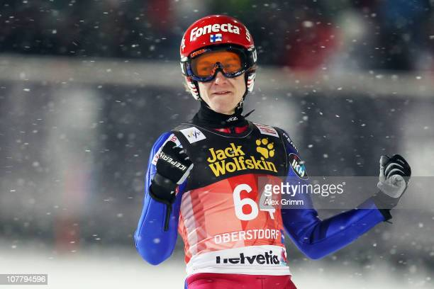 Ville Larinto of Finland reacts after his jump during the qualification round for the FIS Ski Jumping World Cup event at the 59th Four Hills ski...