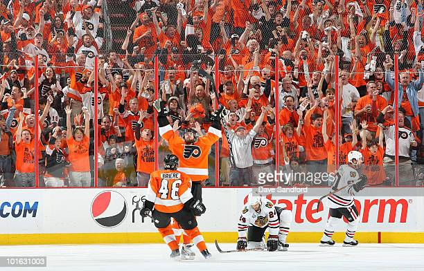 Ville Leino and Daniel Briere of the Philadelphia Flyers celebrate the fourth Flyers goal scored by Leino in the third period of Game Four of the...