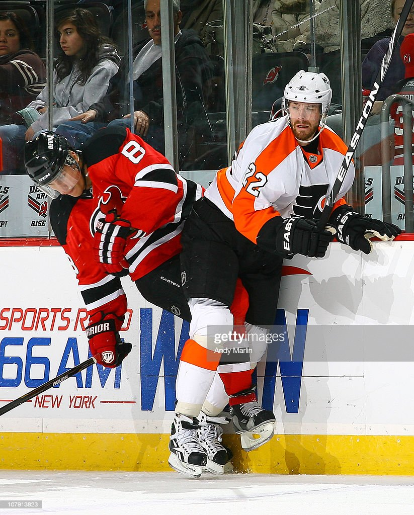 Ville Leino #22 of the Philadelphia Flyers and Dainius Zubrus #8 of the New Jersey Devils come together at the boards during the game at the Prudential Center on January 6, 2011 in Newark, New Jersey.