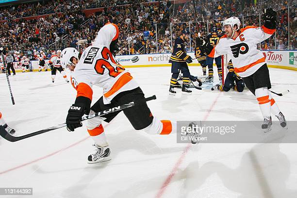 Ville Leino of the Philadelphia Flyers celebrates with teammate Mike Richards after scoring the game winning overtime goal against the Buffalo Sabres...