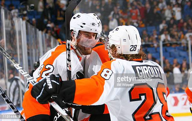 Ville Leino of the Philadelphia Flyers celebrates with teammate Claude Giroux after scoring the game winning overtime goal against the Buffalo Sabres...