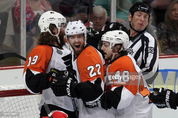 Ville Leino of the Philadelphia Flyers celebrates with teammates Scott Hartnell and Danny Briere after scoring a first period goal against the...