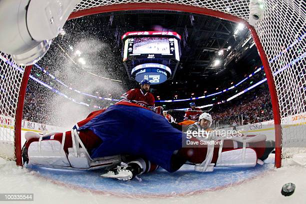 Ville Leino of the Philadelphia Flyers scores a goal past Jaroslav Halak of the Montreal Canadiens in the second period of Game 4 of the Eastern...