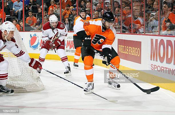 Ville Leino of the Philadelphia Flyers skates with the puck against Derek Morris and Keith Yandle of the Phoenix Coyotes on February 22 2011 at the...