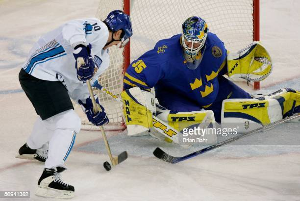 Ville Nieminen of Finland tries to score past goalie Henrik Lundqvist of Sweden during the final of the men's ice hockey match between Finland and...